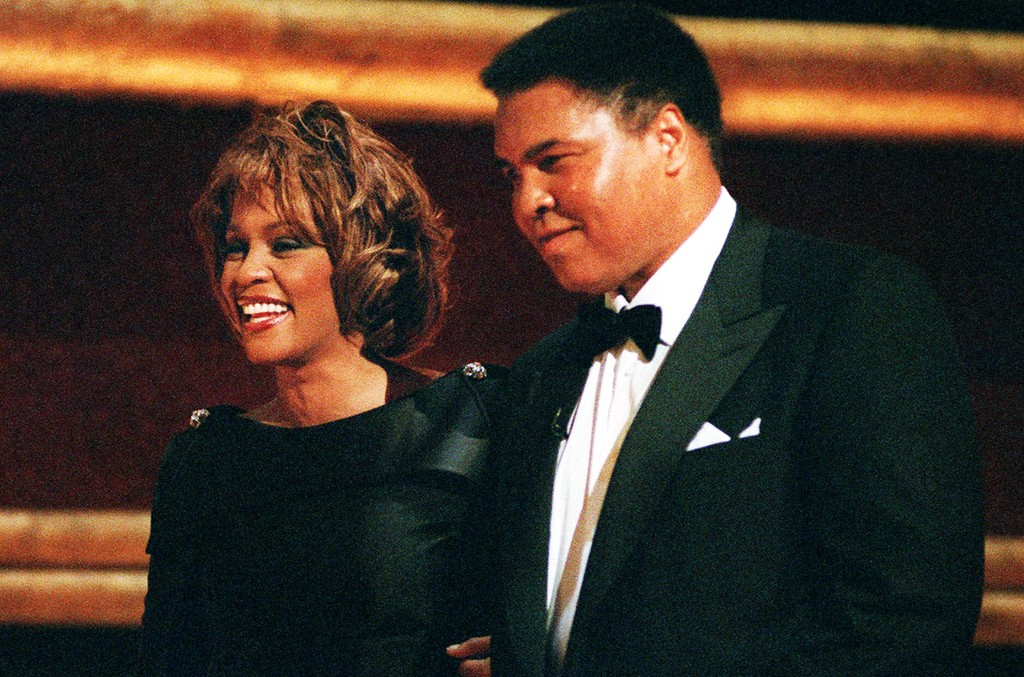 Muhammad Ali is greeted by singer Whitney Houston