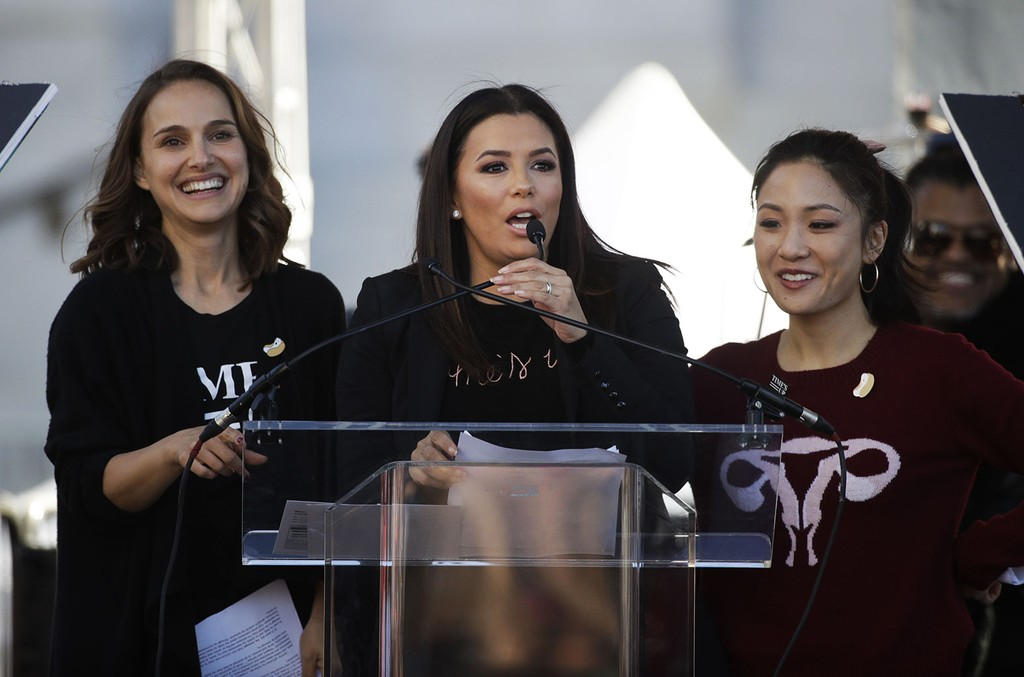 Eva Longoria speaks as she is joined by Natalie Portman and Constance Wu at a Women's March against sexual violence and the policies of the Trump administration in Los Angeles on Jan. 20, 2018.