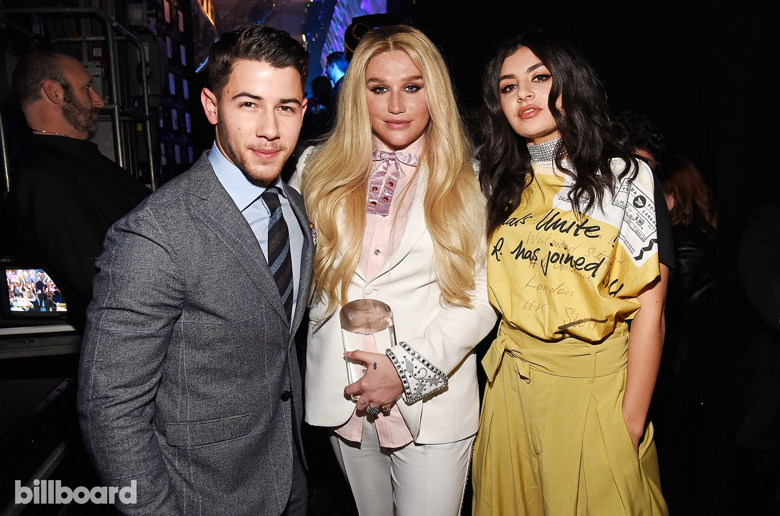 Nick Jonas, Kesha and Charli XCX pose together at the Billboard Women in Music 2016 event on Dec. 9, 2016 in New York City.