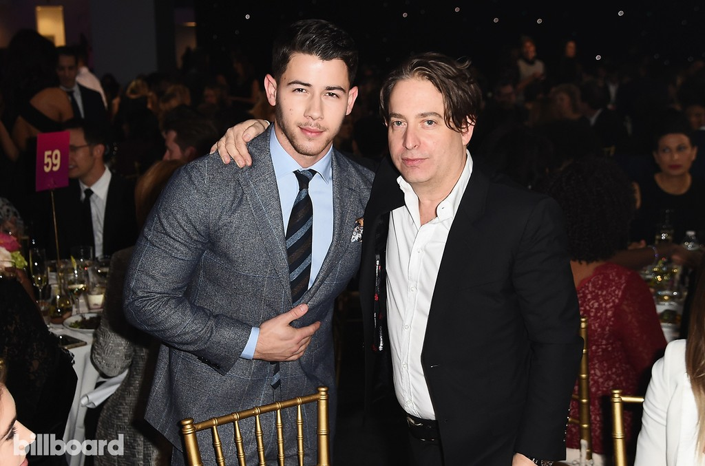 Nick Jonas and Charlie Walk attend the Billboard Women in Music 2016 event on Dec. 9, 2016 in New York City.