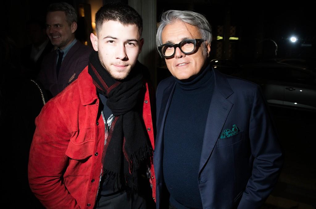 Nick Jonas and Guiseppe Zanotti attends GQ Celebrates Milan Men's Fashion Week during Milan Men's Fashion Week Fall/Winter 2017/18 on Dec. 14, 2016 in Milan, Italy.