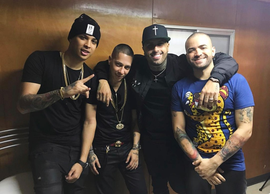 Noriel, Baby Rasta, Nicky Jam and Nacho pose backstage at the Urbanica festival in Monterrey, Mexico.