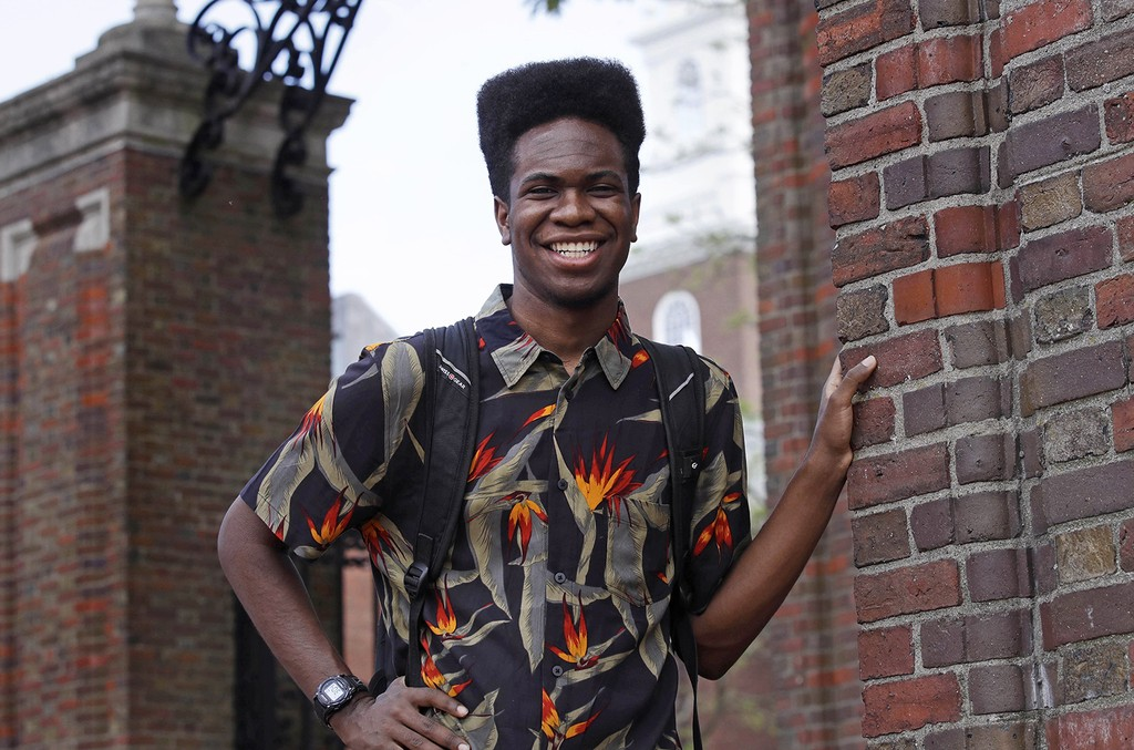 Obasi Shaw poses outside the gates of Harvard Yard in Cambridge, Mass. on May 18, 2017.