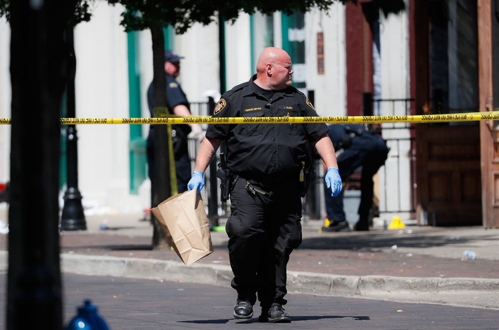 Authorities collect evidence markers at the scene of a mass shooting on Aug. 4, 2019, in Dayton, Ohio.
