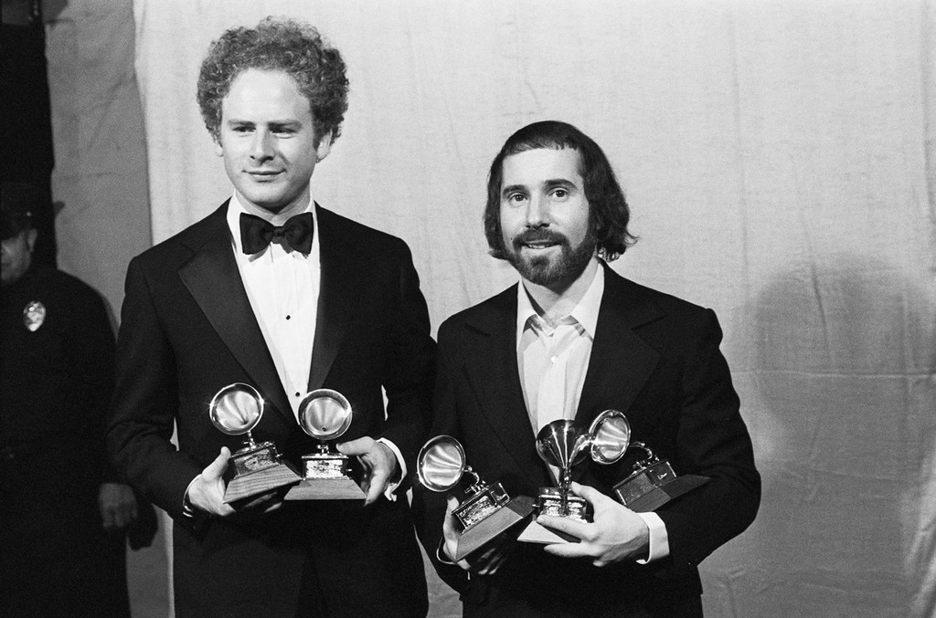 """Arthur Garfunkel (L) and Paul Simon hold a """"Grammy"""" for best record and best album of the year for """"Bridge Over Troubled Water."""""""