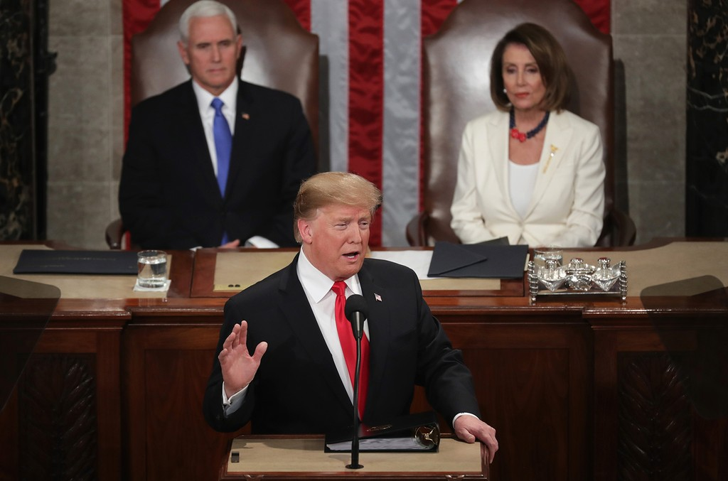 President Donald Trump, with Speaker Nancy Pelosi and Vice President Mike Pence