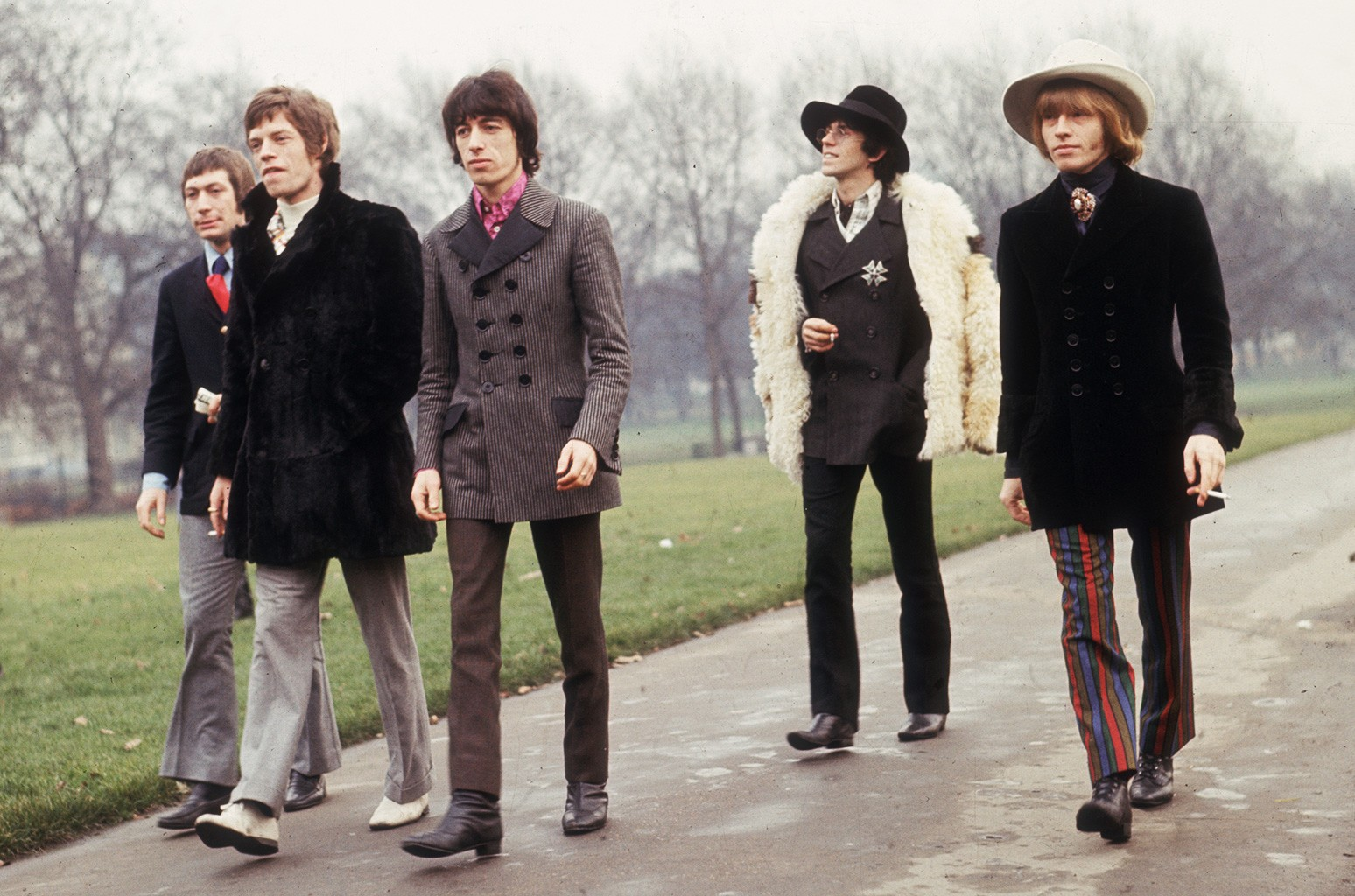 The Rolling Stones take a stroll in a London park.