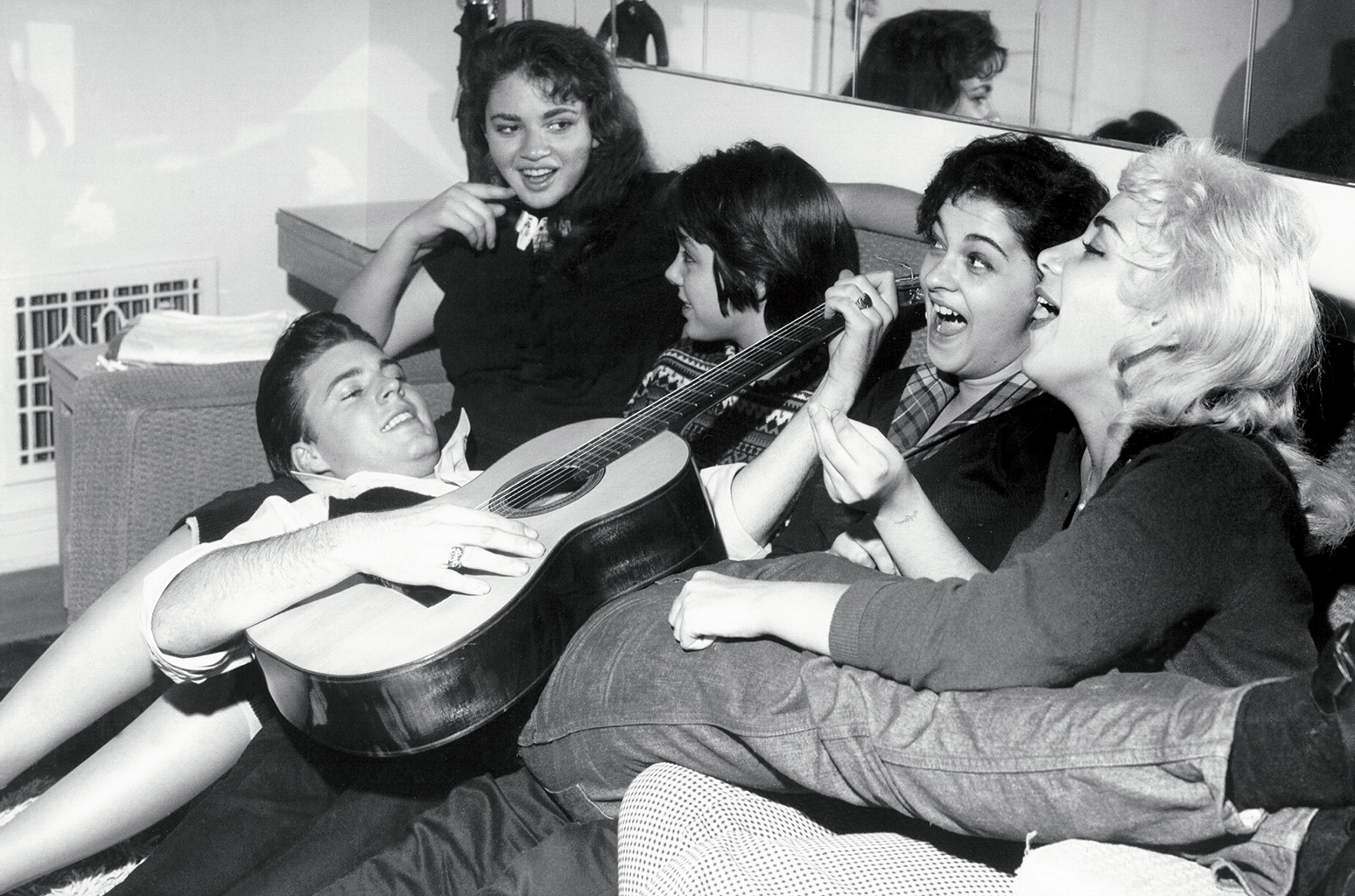 Nelson surroundedby fans in Los Angeles circa 1958.