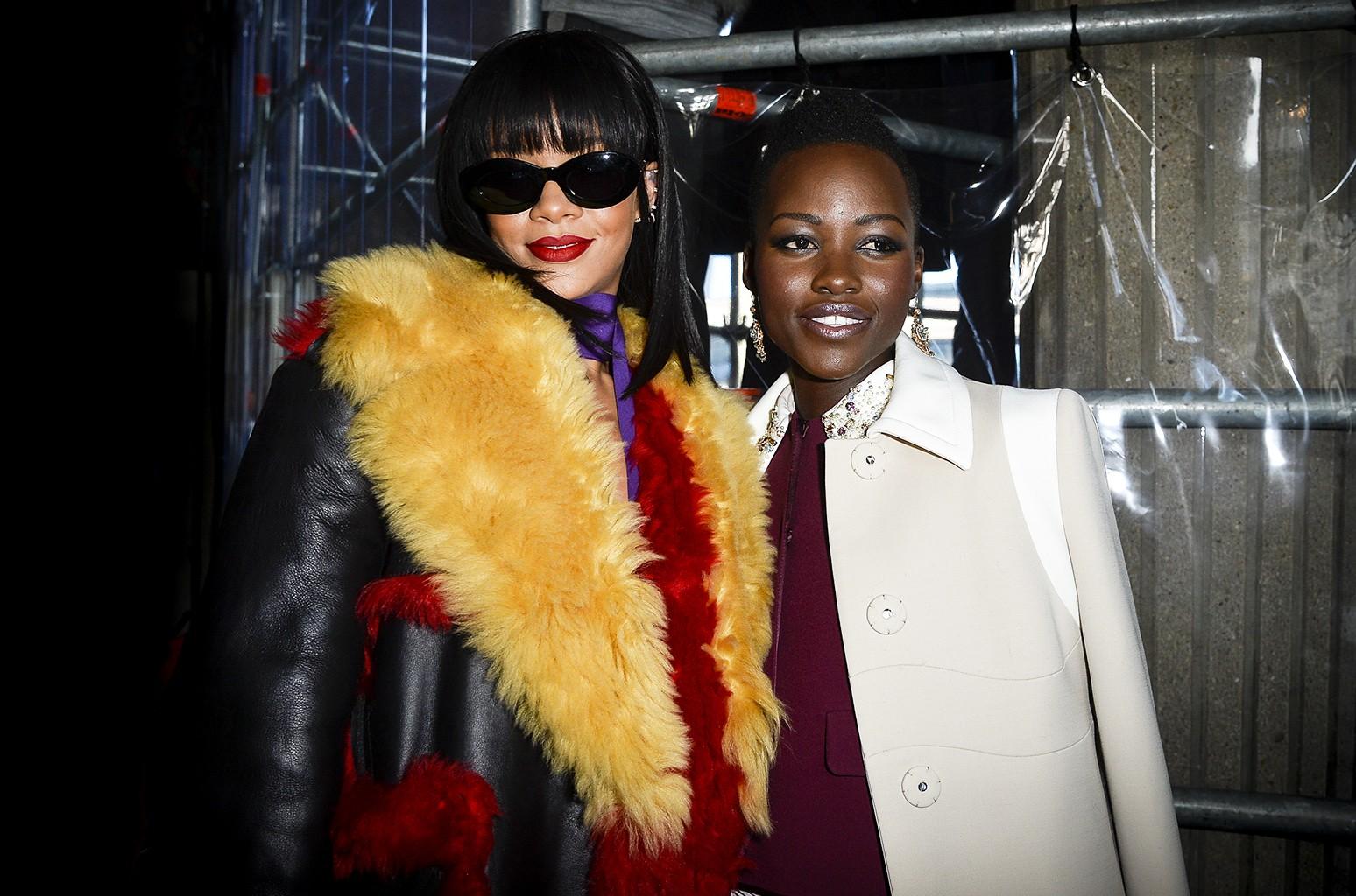 Rihanna and Lupita Nyong'o attend the Miu Miu show as part of the Paris Fashion Week Womenswear Fall/Winter 2014-2015 on March 5, 2014 in Paris.