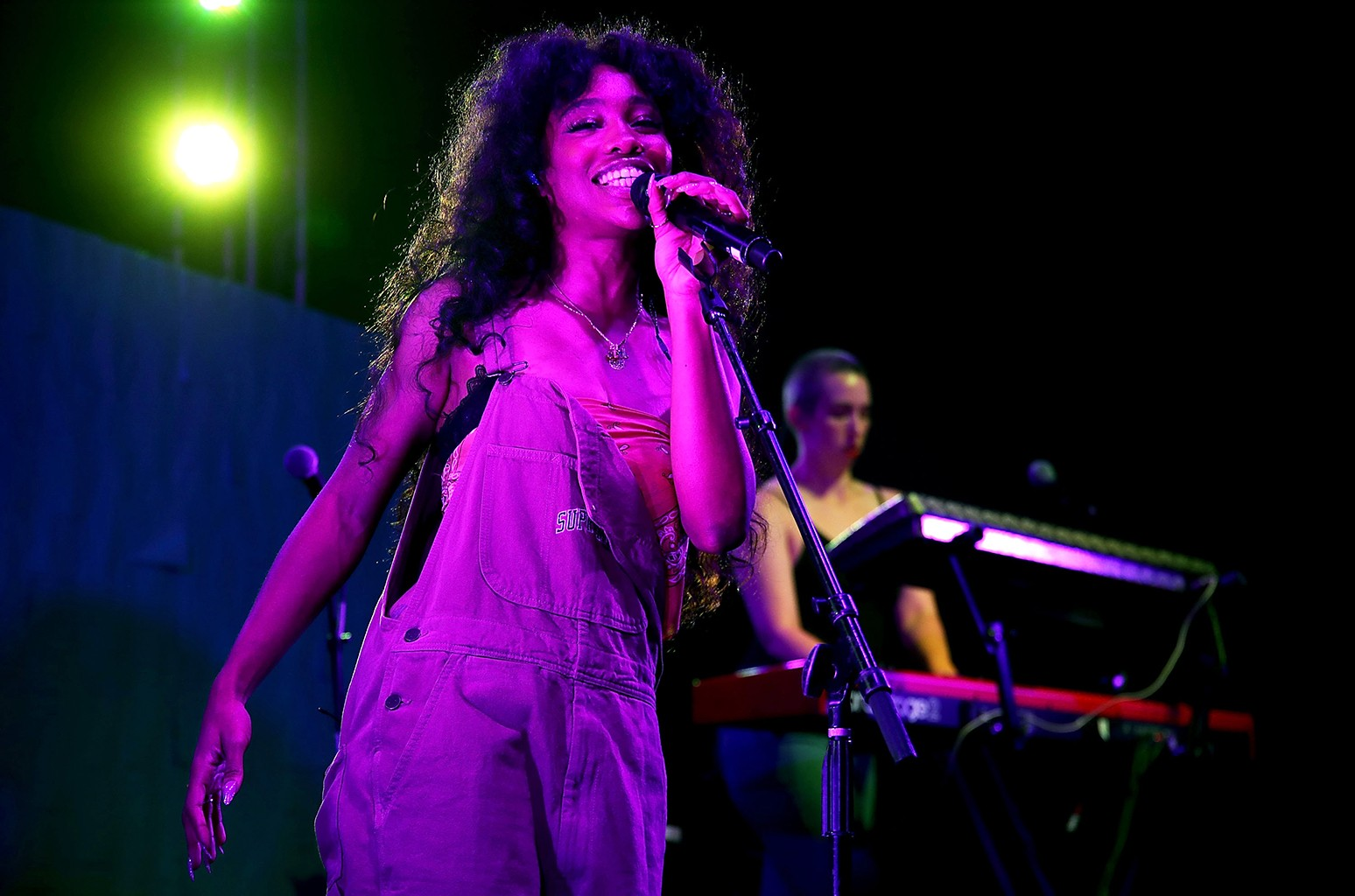 """SZA performs at a block party celebrating HBO's new season of """"Insecure"""" on July 15, 2017 in Inglewood, Calif."""
