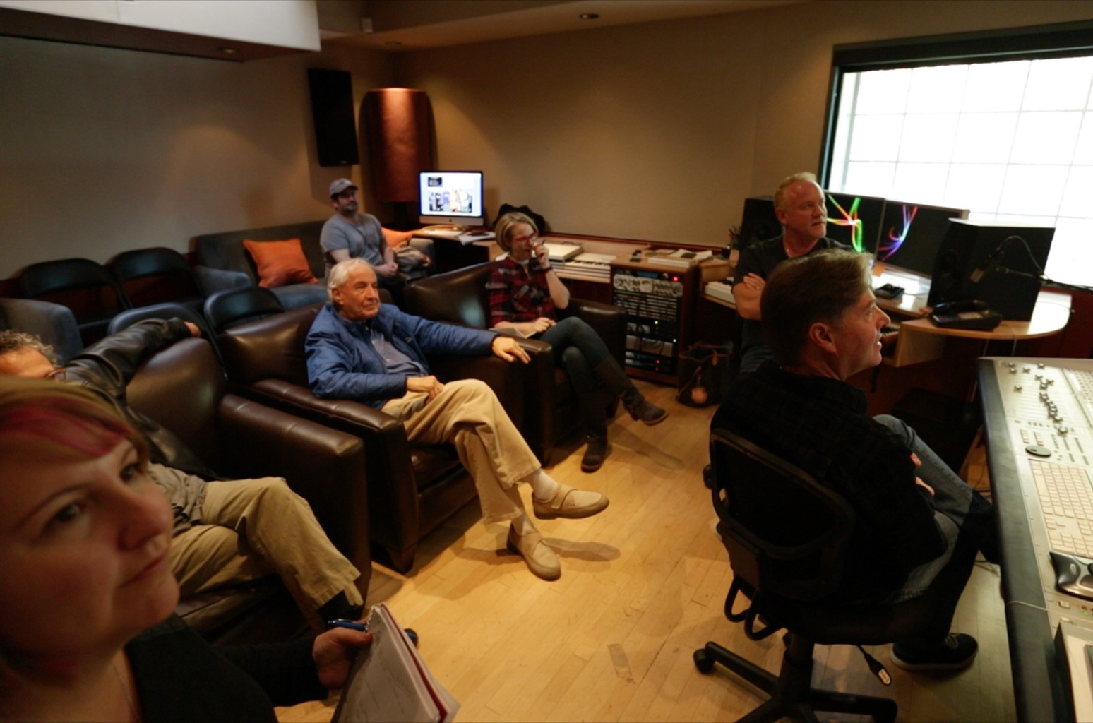 Late director Garry Marshall, seated center, and composer John Debney, second from right, in a scene from Score.