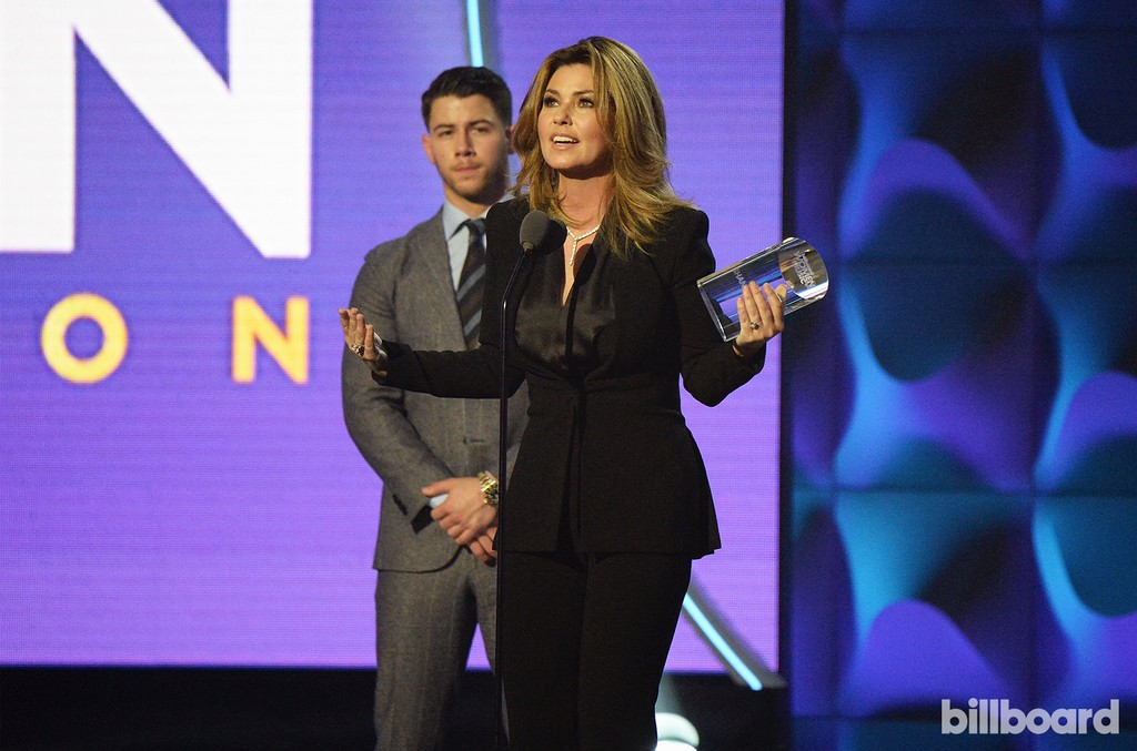 Shania Twain accepts an award on stage from Nick Jonas at the Billboard Women in Music 2016 event on Dec. 9, 2016 in New York City.