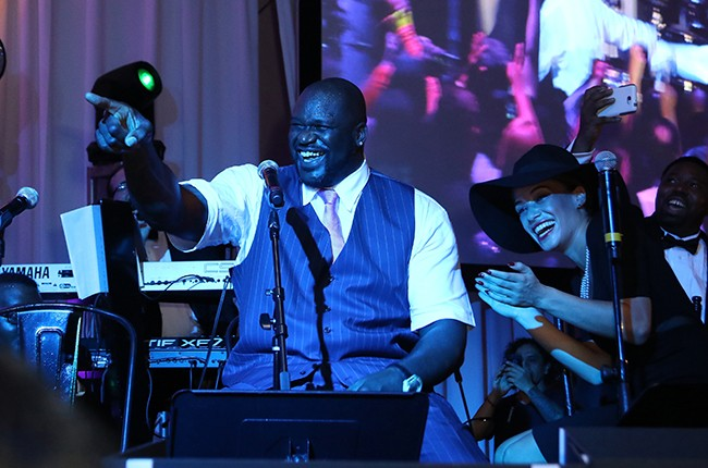 Shaquille O'Neal and Laticia Rolle onstage at Barry University's 75th Anniversary Birthday Bash