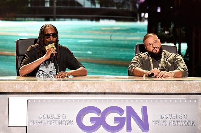 Uncle Snoop and DJ Khaled speak onstage at the BET Hip Hop Awards Show
