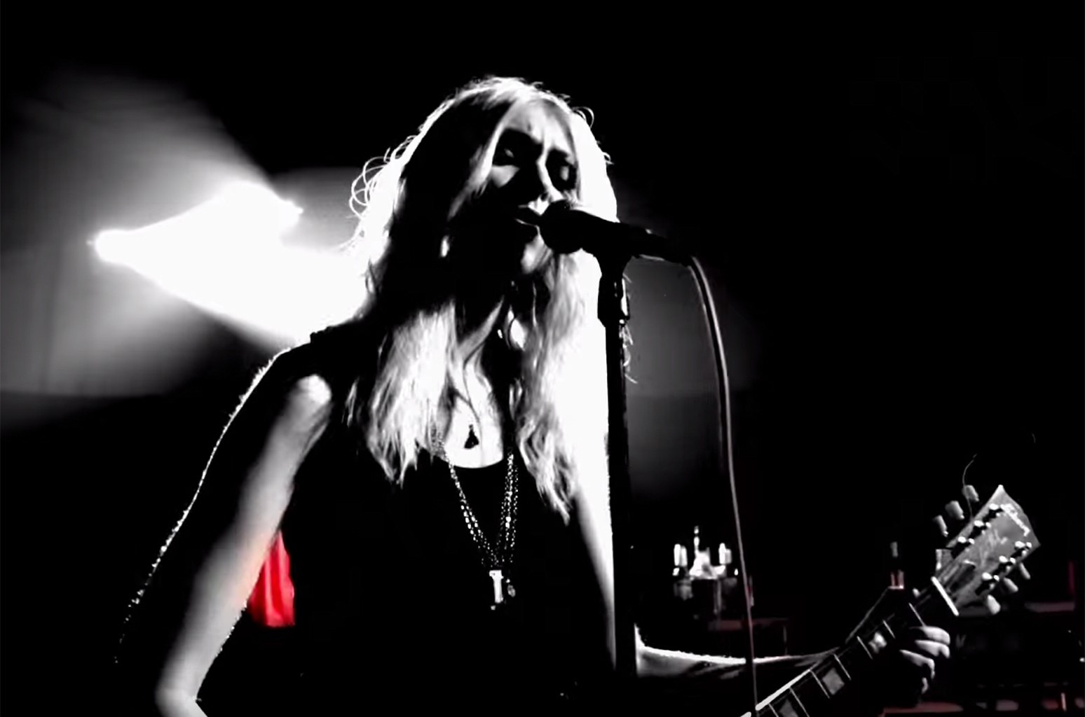 "The Pretty Reckless in the video for ""Take Me Down."""