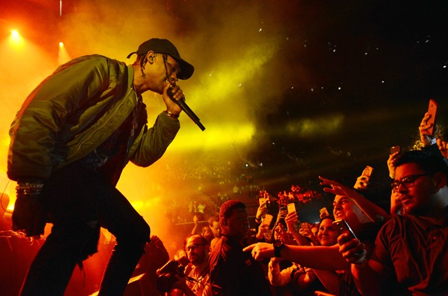 Travis Scott performs onstage at The Forum on December 8, 2015 in Inglewood, Calif.