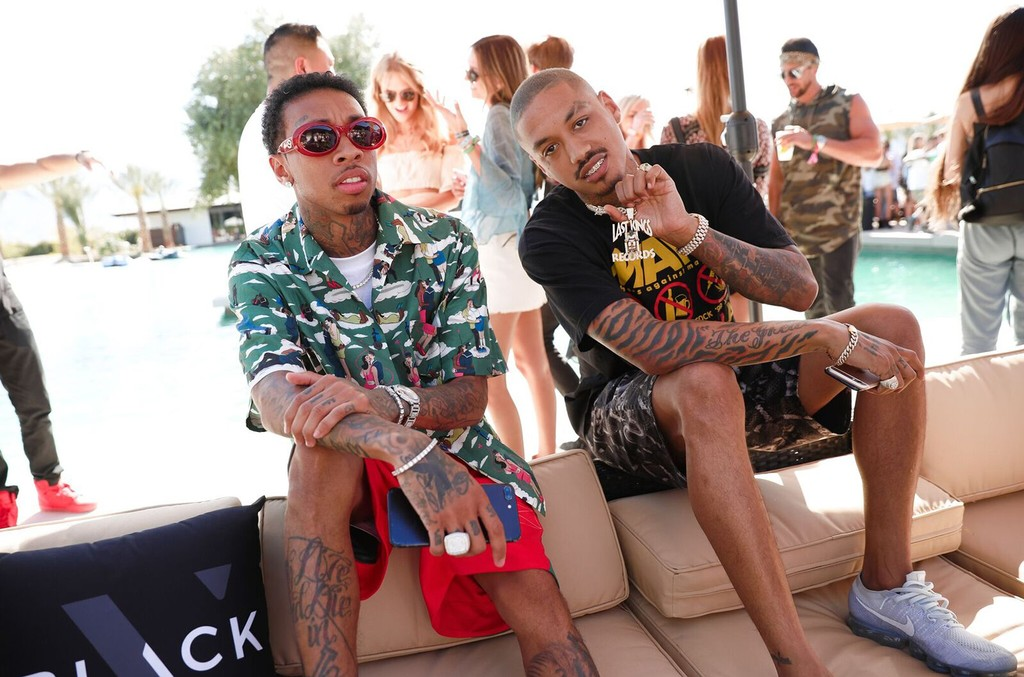 Tyga and guest hang out at The VELOCITY BLACK x 1 OAK / Up & Down Desert Beach Club on April 16, 2017.