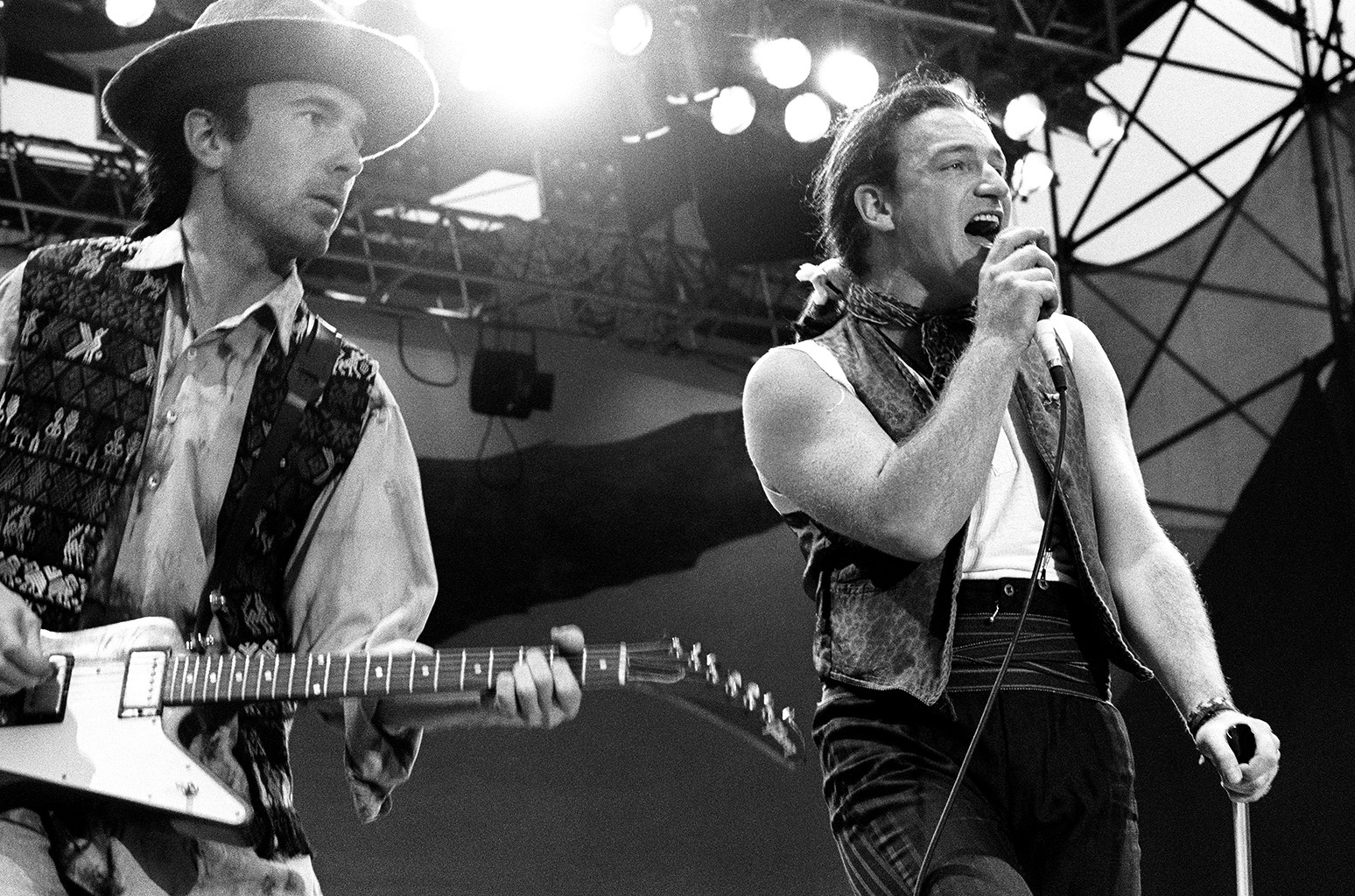 The Edge and Bono of U2 perform during The Joshua Tree Tour on July 10, 1987.