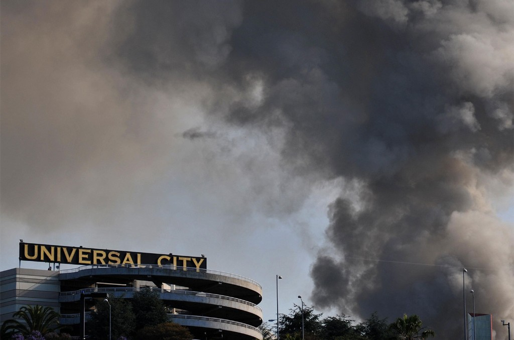 Smoke rises over burning structures at Universal Studios, in Universal City, California, on June 1, 2008.
