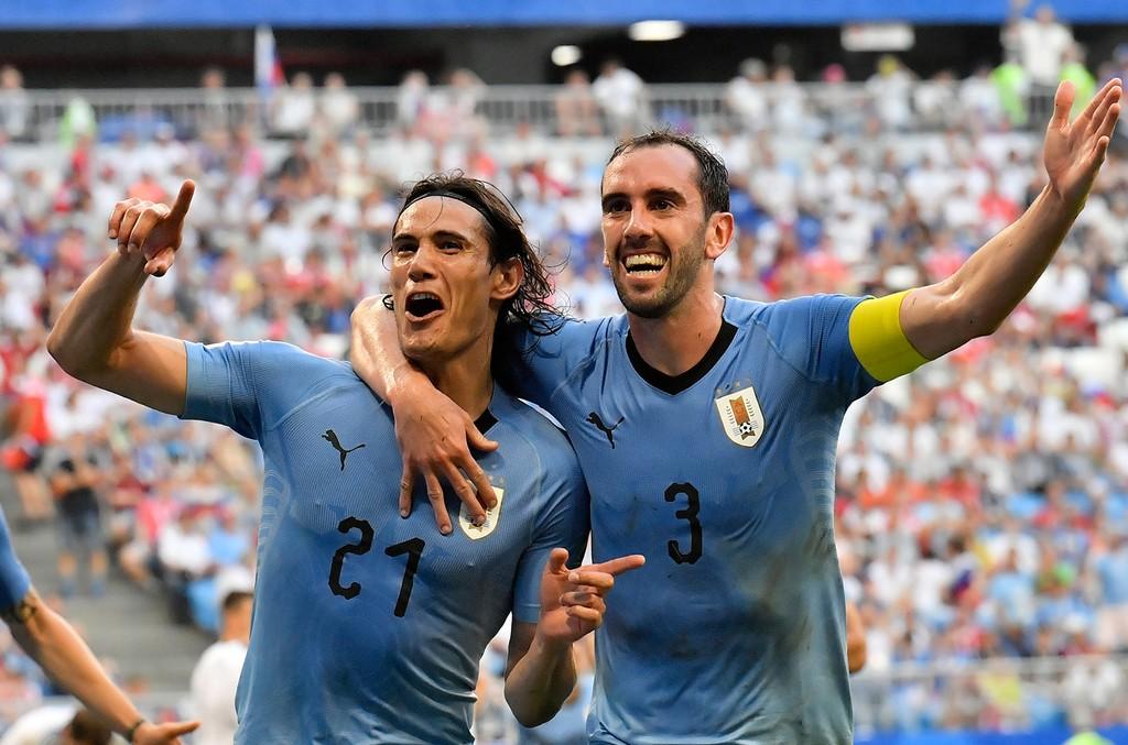 Uruguay's Edinson Cavani celebrates with teammate Diego Godin