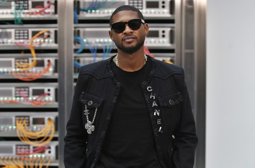 Usher poses for photographers prior to Chanel's Spring-Summer 2017 ready-to-wear fashion collection presented Oct. 4, 2016 in Paris.