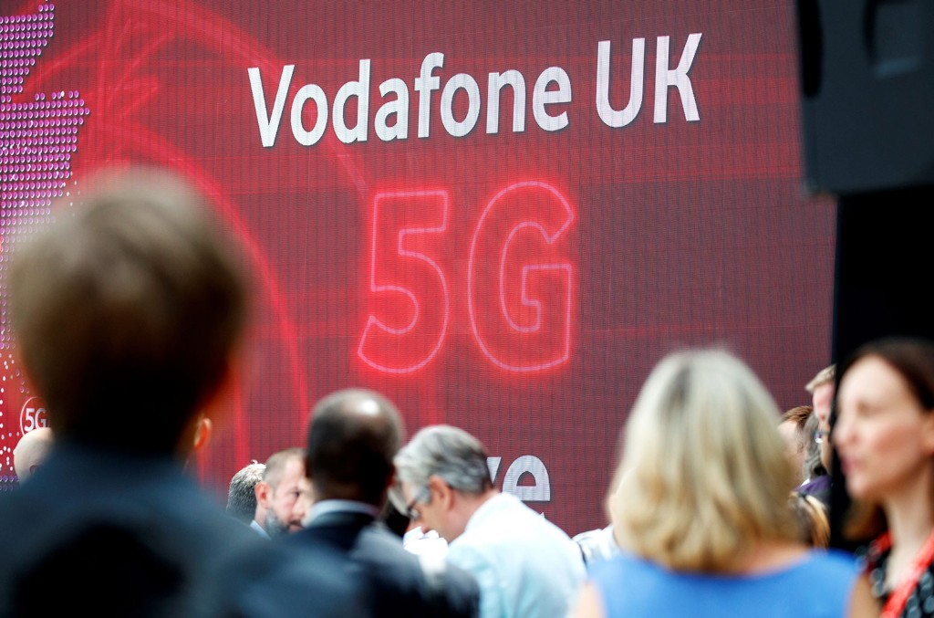 The 5G logo is pictured during the launch of Vodafone UK's 5G mobile data network in London on July 3, 2019.