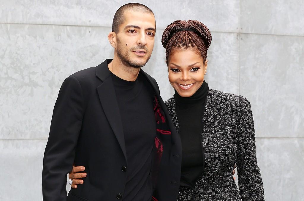Wissam al Mana and Janet Jackson attend the Giorgio Armani fashion show during Milan Fashion Week.