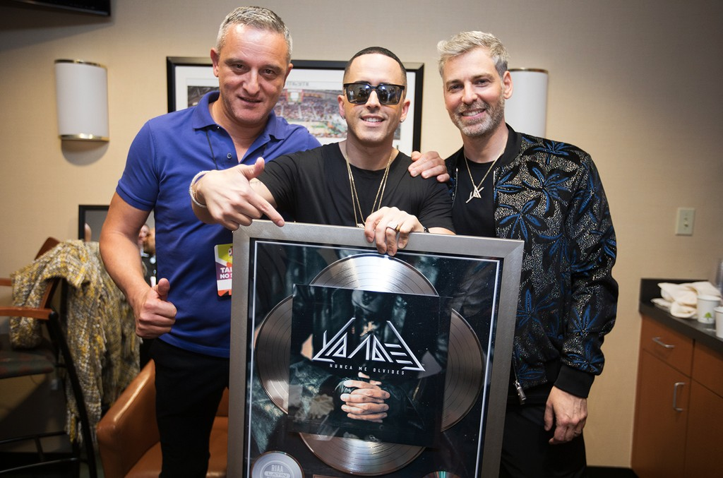 "Nir and Lorenzo from Sony Music Latin presented Yandel a plaque for his song, ""Nunca Me Olvides"" going 4X Platinum on July 6, 2017."
