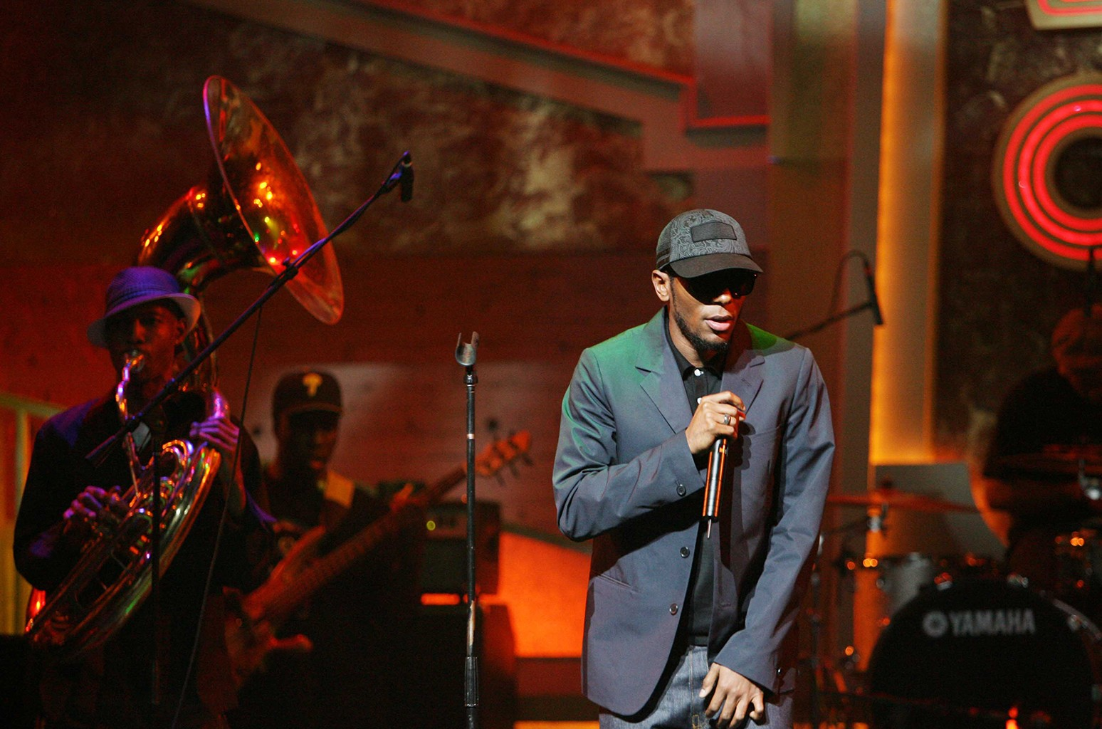 Mos Def performs at the Apollo