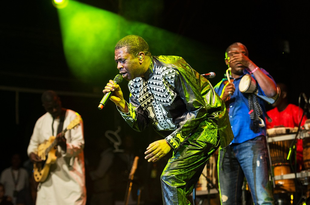Youssou N'Dour performs on the Open Air stage as he headlines Womad at Charlton Park on July 26, 2014 in Wiltshire, United Kingdom.