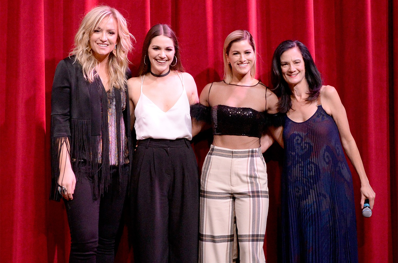 Clare Dunn, Hannah Ellis, Cassadee Pope and Senior Vice President of Music Strategy for CMT Leslie Fram take photos onstage during the 2018 CMT Next Women of Country event at City Winery Nashville on Nov 13, 2018 in Nashville.