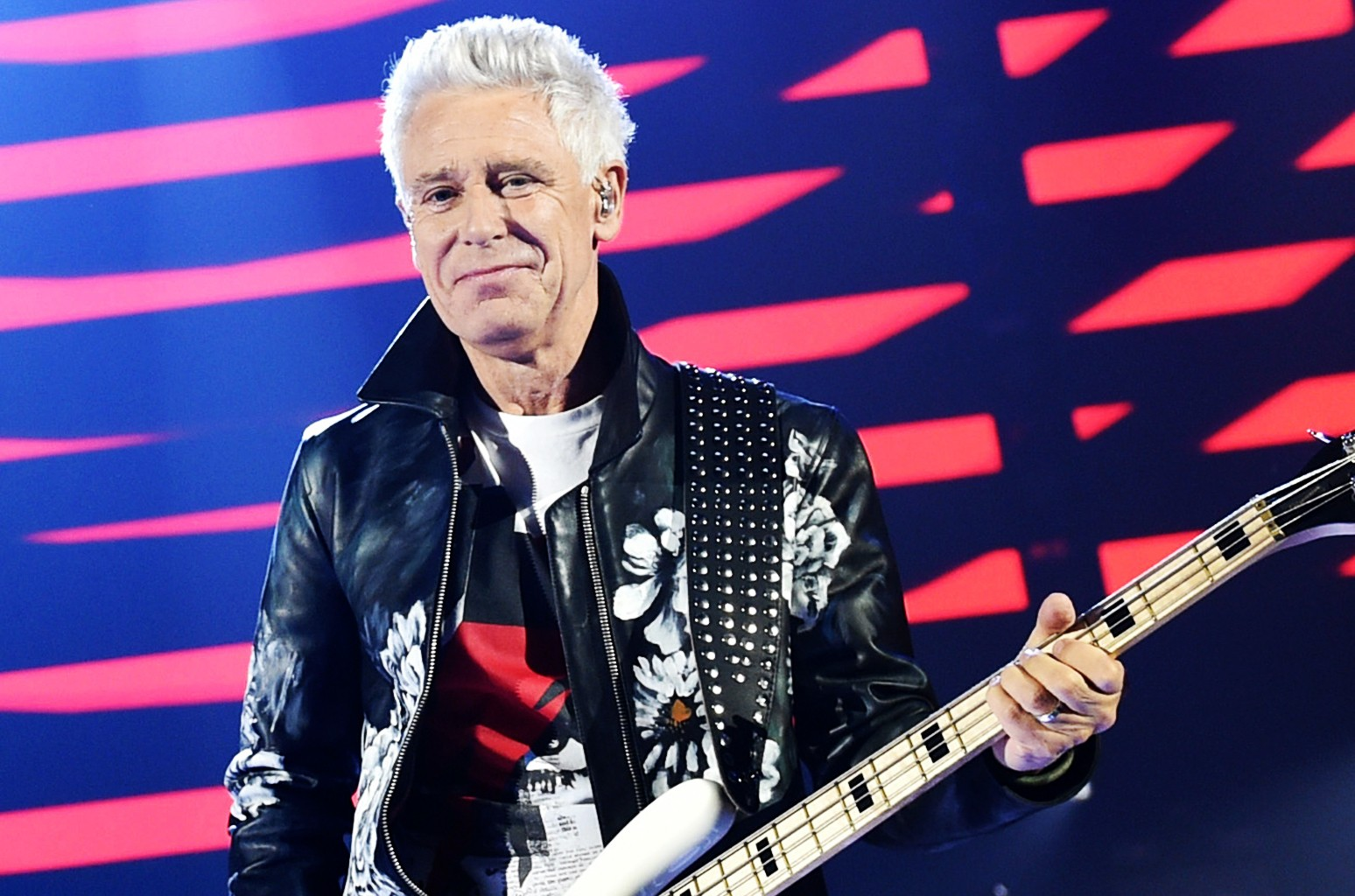 Bassist Adam Clayton of U2 performs onstage at the 2016 iHeartRadio Music Festival at T-Mobile Arena on Sept. 23, 2016 in Las Vegas.