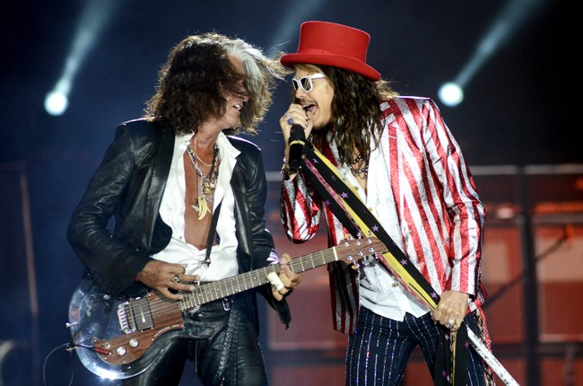 """Joe Perry and Steven Tyler of Aerosmith perform during the band's """"Blue Army Tour 2015"""" at Harvey's Lake Tahoe Outdoor Amphitheater on July 3, 2015 in Stateline, Nevada."""