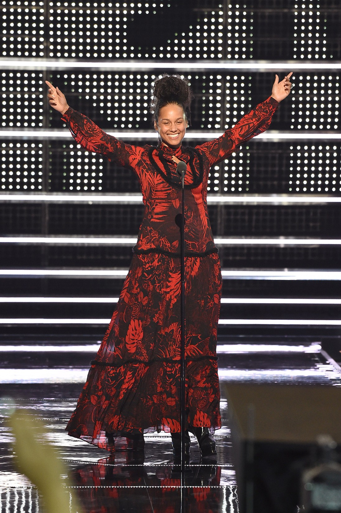 Alicia Keys presents onstage during the 2016 MTV Video Music Awards