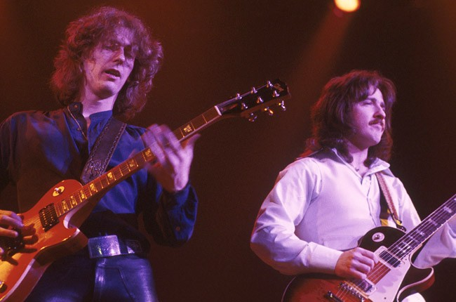 Allen Lanier and Buck Dharma from Blue Oyster Cult perform on stage, United States, circa 1977