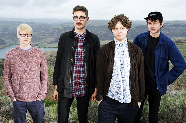 Alt-J pose for a portrait backstage on Day 4 of Sasquatch