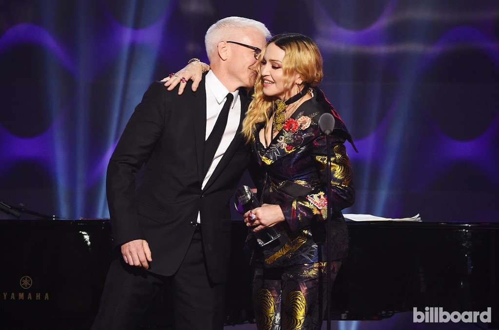 Anderson Cooper and Madonna share a moment on stage at the Billboard Women in Music 2016 event on Dec. 9, 2016 in New York City.