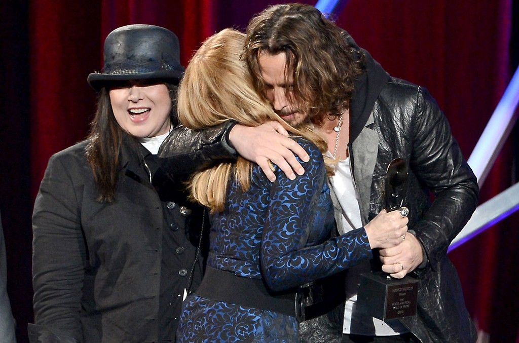 (L-R) Inductees Ann Wilson and Nancy Wilson of Heart and presenter Chris Cornell speak onstage at the 28th Annual Rock and Roll Hall of Fame Induction Ceremony at Nokia Theatre L.A. Live on April 18, 2013 in Los Angeles.