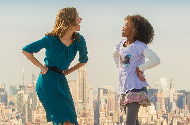 Grace (Rose Byrne) and Annie (Quvenzhané Wallis) sing in Columbia Pictures' Annie.