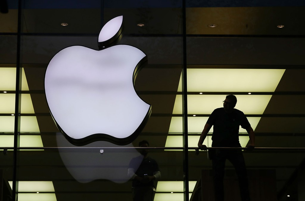 A silhouette next to an Apple during the sale start of the new iPhone X at the Apple store Grosse Bockenheimer Strasse in Frankfurt, Germany on Oct. 3, 2017.