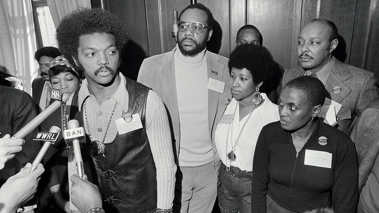 <p>Franklin was committed to social justice, appearing with Rev. Jesse Jackson (far left) and Tom Todd at an event for their Operation PUSH in 1972.</p>