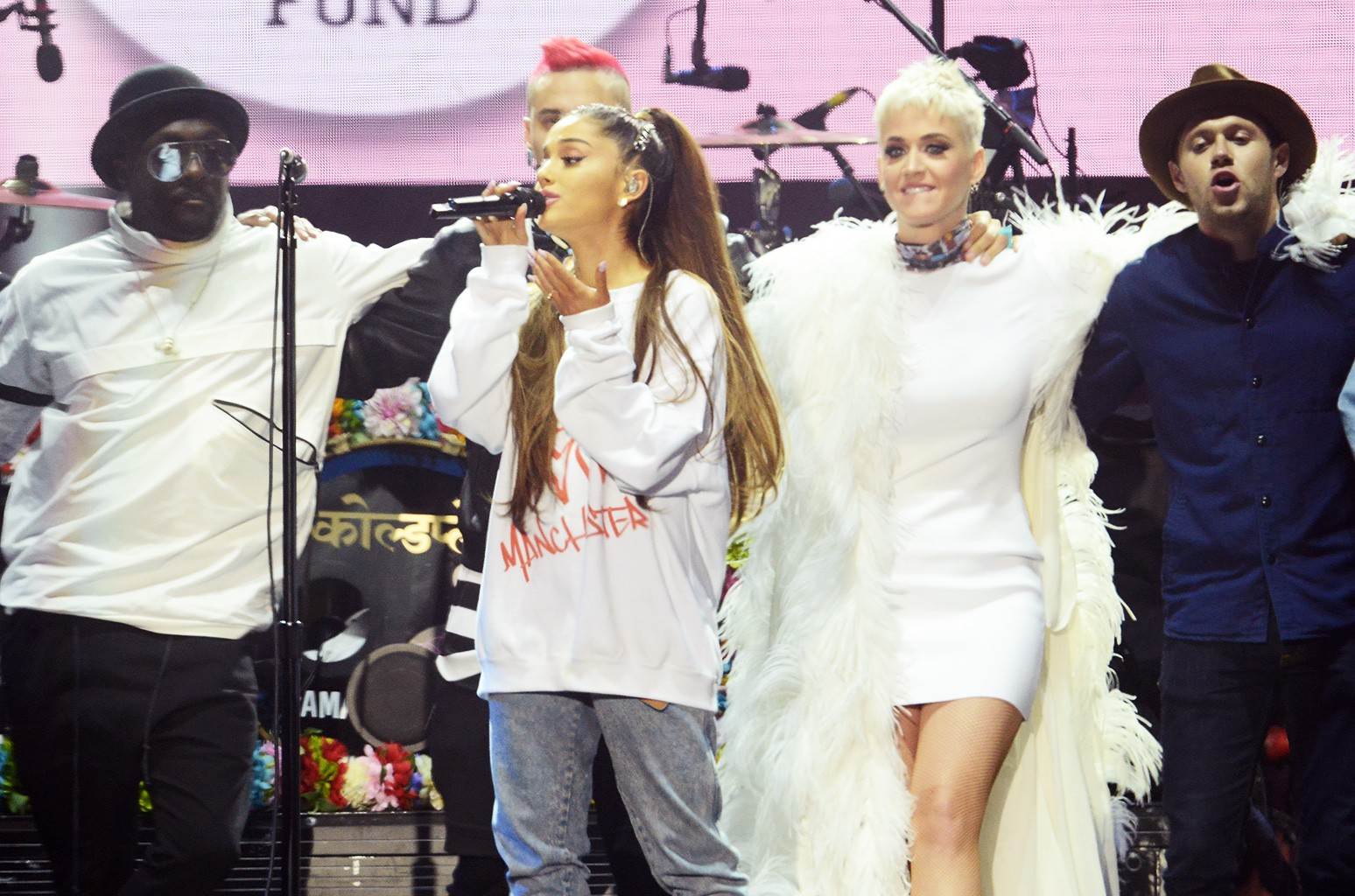 will.i.am, Taboo, Ariana Grande, Katy Perry, Niall Horan, Miley Cyrus and Imogen Heap on stage on June 4, 2017 in Manchester, England.