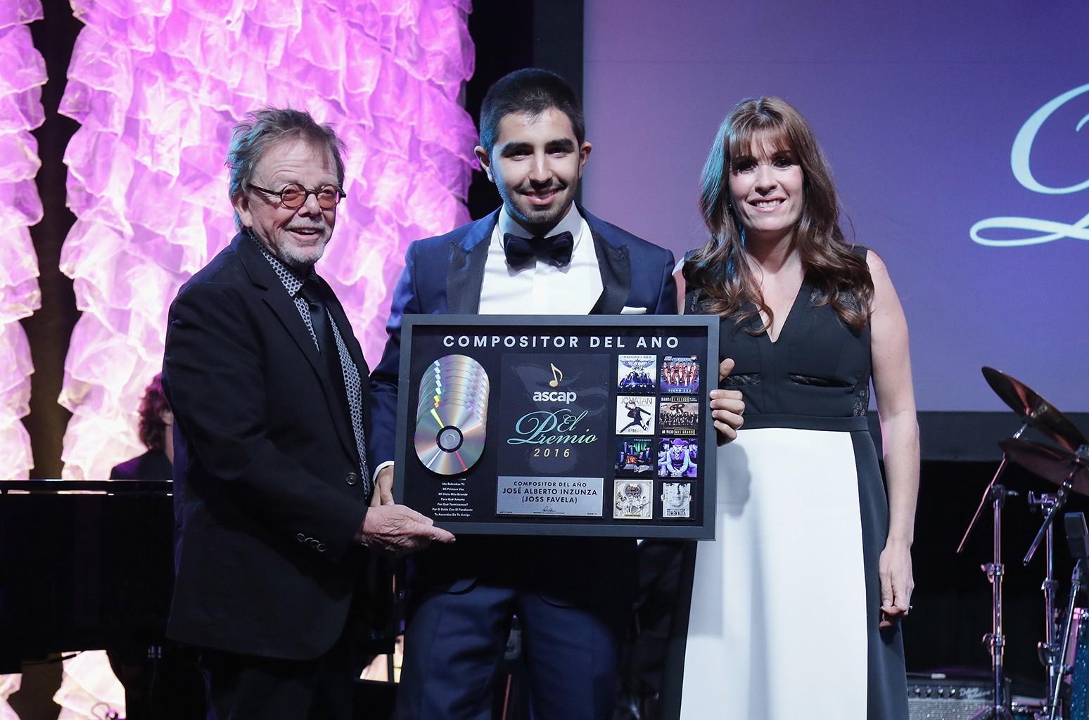 Joss Favela accepts an award from ASCAP at the Latin Music Awards