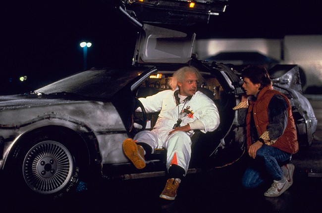 Christopher Lloyd (as Dr. Emmett Brown), Michael J. Fox (as Marty McFly)