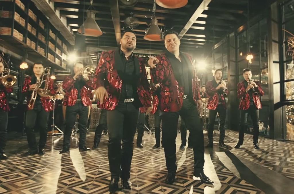"""Banda MS in the video for """"Santa Claus Llego a la Ciudad."""""""