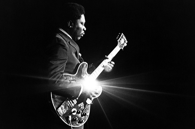 BB King playing guitar live on stage.