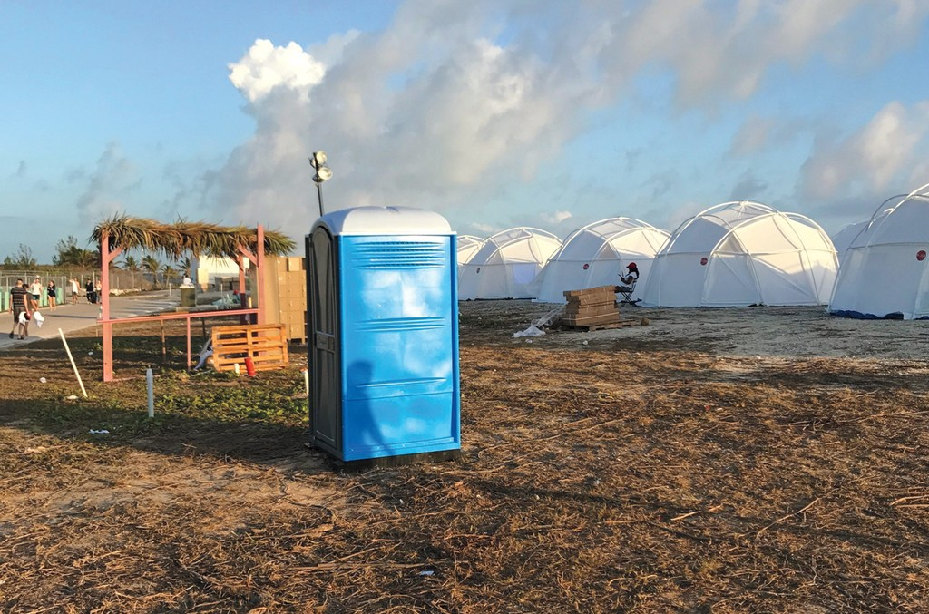 A lone Porta-Potty sat outside an encampment of tents at The Fyre Festival in the Exumas.