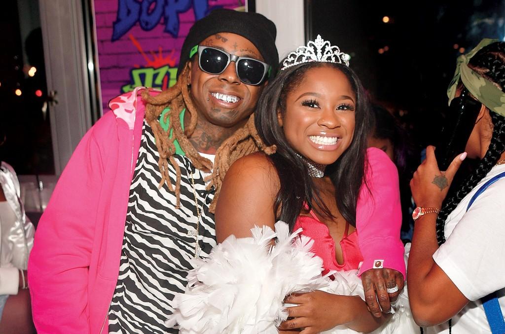 Lil Wayne and Reginae Carter attend Reginae Carters Birthday Party at Suite Lounge on Dec. 2, 2016 in Atlanta.