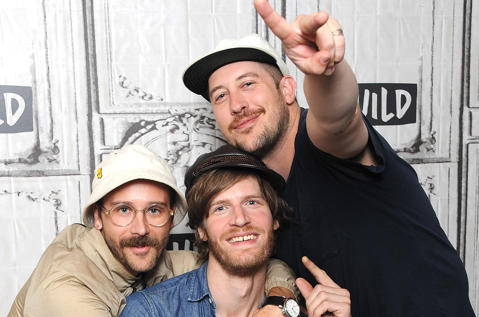 (L-R) John Gourley, Eric Howk and Zach Carothers of the band Portugal. The Man attend Build to discuss their eighth studio album 'Woodstock' at Build Studio on June 20, 2017 in New York City.