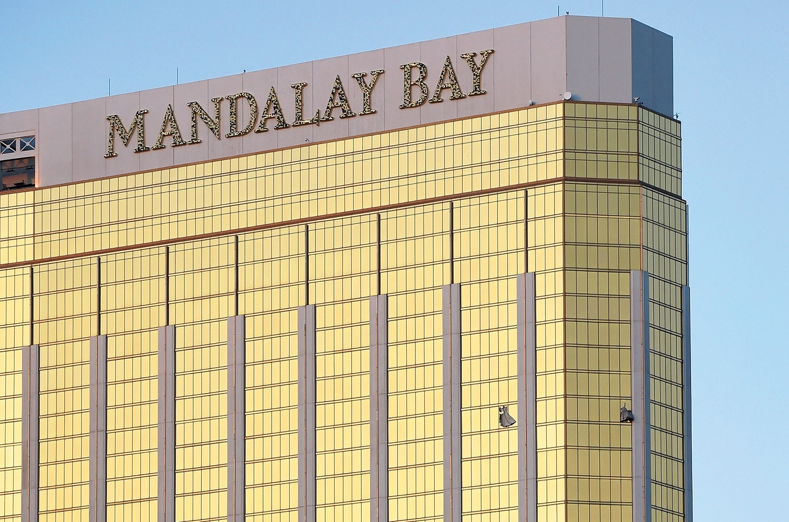 Tarps cover broken windows in The Mandalay Bay Resort and Casino  where the gunman opened fire on the crowd.